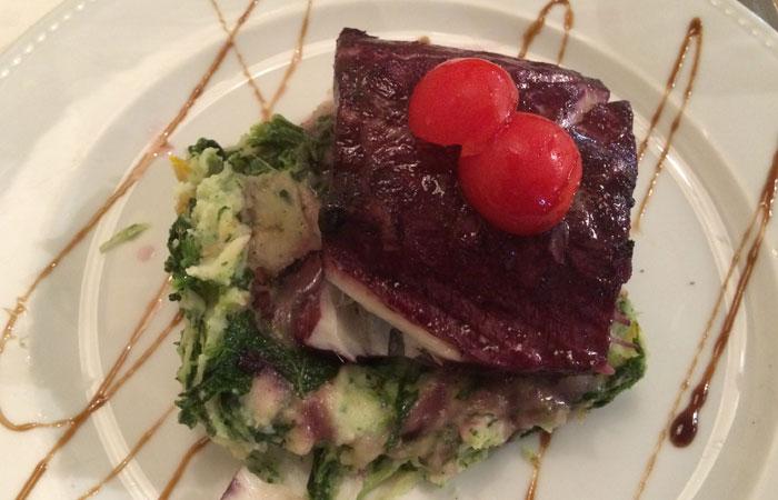 Bacalao confitado con vino de Oporto del Restaurante Bacalhoeiro comer en Oporto